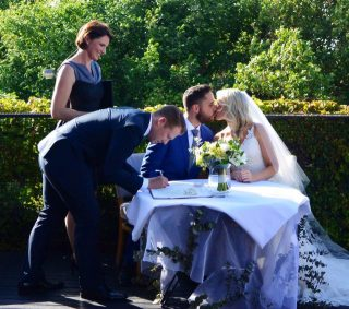 Signing the Register with wedding celebrant