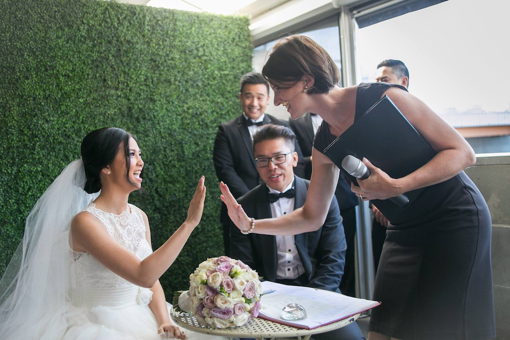 Signing the marriage register with Melbourne Celebrant Meriki Comito