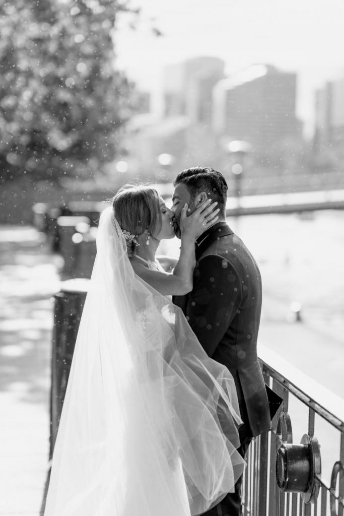 Wedding kisses in the rain
